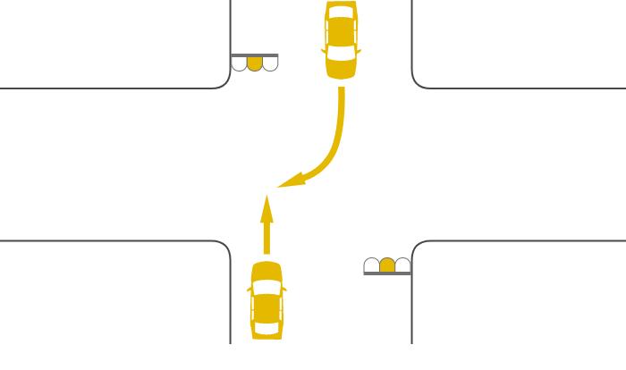 ともに黄信号で交差点を直進する車と右折する対向車の事故
